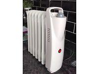 Mini oil filled radiator
