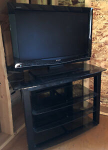 """Sharp Aquos 32"""" High Definition LCD TV with matching stand."""