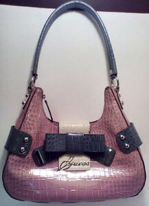 GUESS: Pink and Grey Pretty Bow Purse.