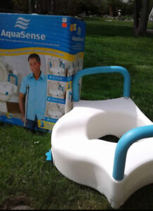TOILET SEAT  LIFT gently used