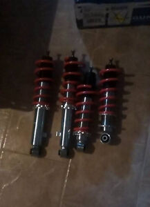 Brand new in box NA miata coilovers,