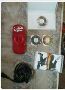 red god of war psp with 3 games and a movie