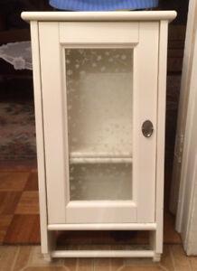Shelf with decorative glass door