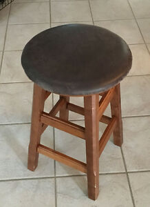 """Two brown 24"""" high stools with rotating seat"""