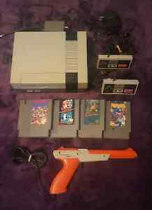 Nintendo with games, gun, controllers  and all cords