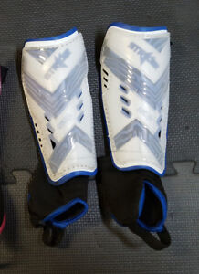 Soccer shin guards for junior age.