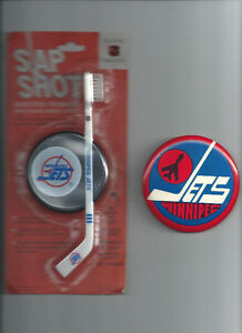 OLDER NHL WINNIPEG JETS LARGE BUTTON AND UNOPEN TOOTH BRUSH
