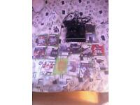 XBox 360 slim boxed 2 controllers games included