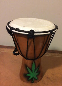 Djembe with cannibis leaf painted on   8 inches in height