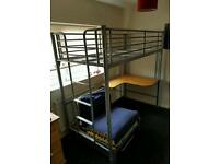 Metal framed high bed with futon and desk