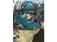 Suitcase and hand luggage bag