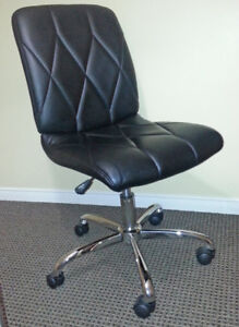 black padded chairs with chrome legs and rollers