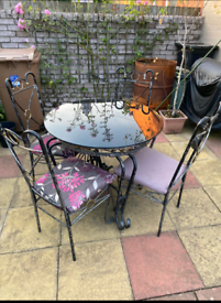 Up cycled cast iron table and chairs