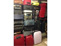 FIVE MIXED UPRIGHT SUITCASES - USED COLLECT FROM RADLETT HERTFORDSHIRE