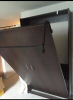 Twin size Murphy bed or wall bed.