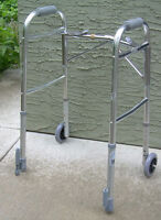Walking frame with front wheels