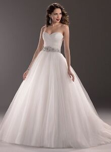 New princess style wedding dress never worn or altered