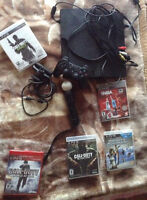 Slim PS3 320gb for sale with 5 games