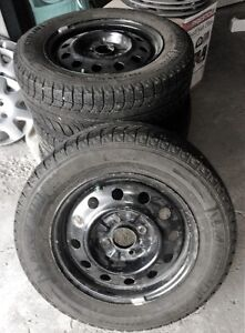 Set of 4 Michelin X-Ice Winter Tires on rims - Size 205/65 R15