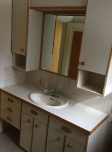 Beige sinks and toilets  and cupboards 1 jacuzzi in 2  Bathroom