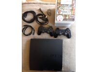 Playstation 3 with 2x controllers and 11 games included