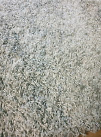 A new stlyish thick silver grey shaggy rug.