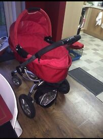 Red quinny pushchair/carrycot plus extras