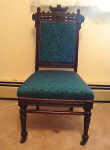 EASTLAKE UPHOLSTERED ANTIQUE CHAIR WITH ROLLERS