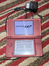 Nintendo DSi XL and 8 games