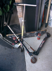 2 scooters and skateboard