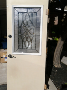 Exterior Door with decorative glass insert and hardware