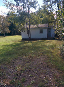 Wooded property and house for sale.