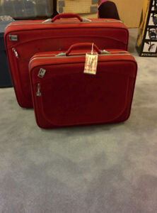 two matching vintage red suitcases
