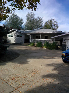 1.2 ACRES IN THE CITY OF MEDICINE HAT, 1750 SQ FT HOME