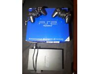 Sony PlayStation 2 with box two controllers
