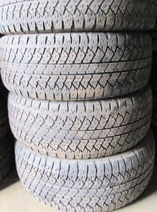 4 Tires sized 285.45.22 at 70-75% Tread left on them