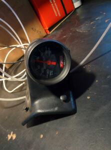 Black TRD boost gauge with Autometer black a-pillar pod mount
