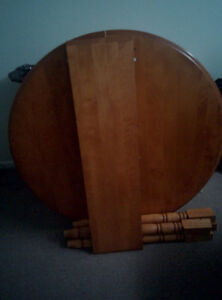 Wooden dinning room table set with leaf and two chairs
