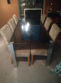 Glass table dining table and 6 chairs chairs