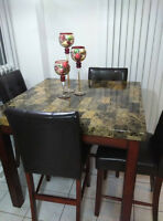Laminate table with 4 leather chairs