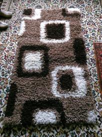 Small brown shaggy mat - £8
