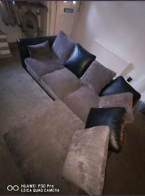 Right hand black and grey (slate) corner sofa.