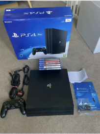 PS4 PRO with box and controler / cables etc. Like new