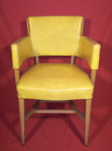 Pair of yellow vinyl spring loaded armchairs