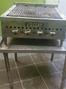 used restaurant flat grill and table, hot water tank, resturant