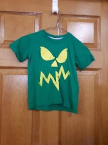 Green T-Shirt with Yellow Face Size: 4