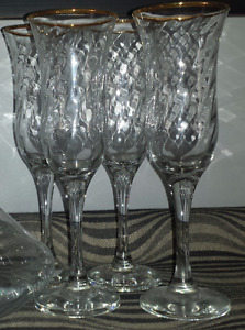4 gold rimmed wine glasses