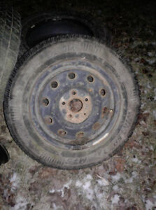 4 really good winter tires with rims 205 15 R70 for sale.