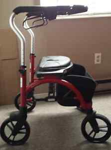 Black and red Walker and a seat in one, holds up to 300 pounds