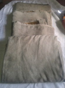 """4 panels of suede grommet style curtains. 90"""" x 54"""" each."""
